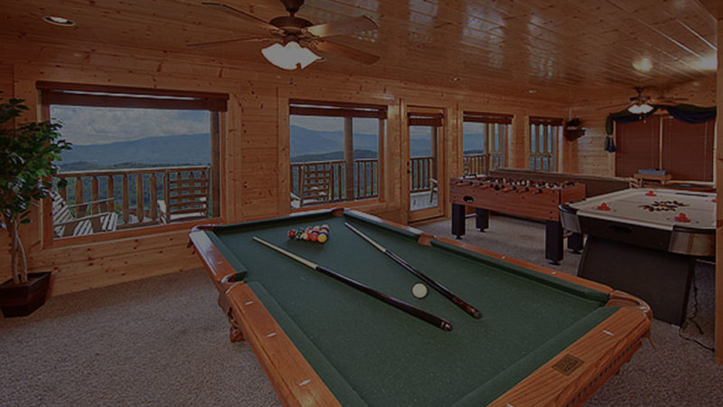 Large game room with pool table and air hockey at Gatlinburg cabin with mountain view