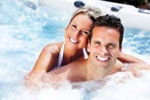 Happy_couple_enjoying_their_Gatlinburg_cabin_with_a_hot_tub