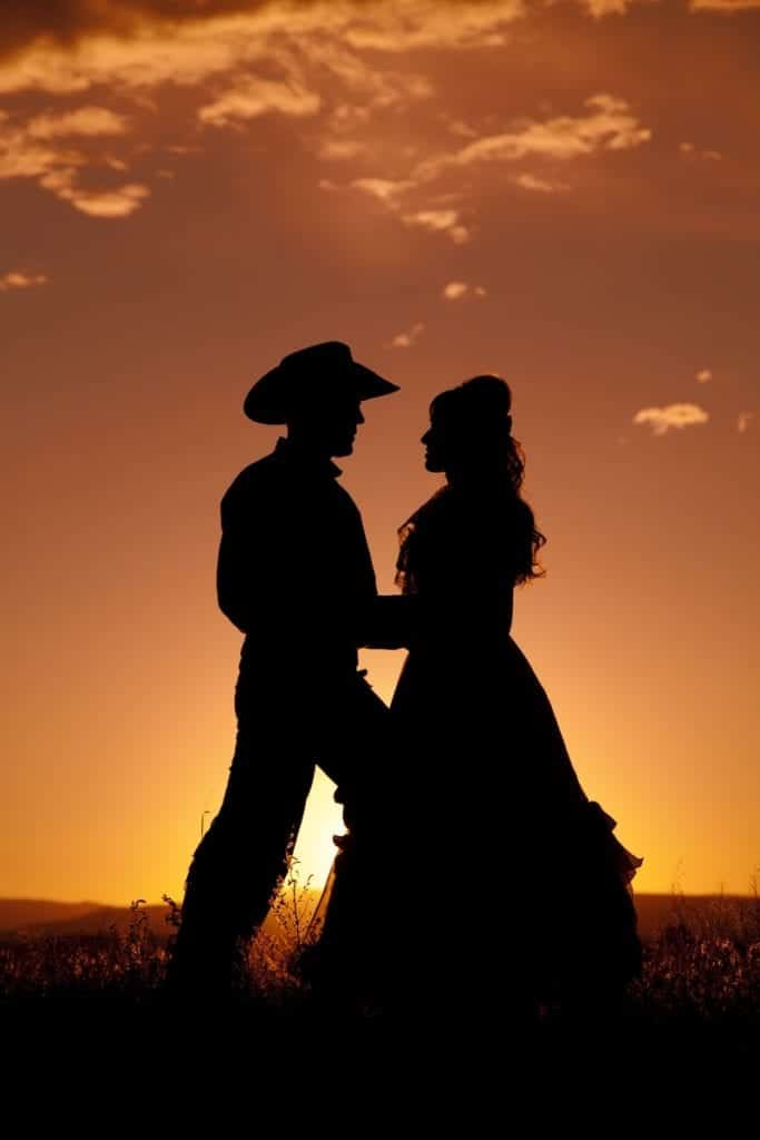 cowboy and girlfriend dancing at sunset
