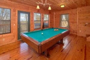 pool table inside family friendly cabin in Gatlinburg