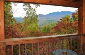 Scenic views of the fall colors in the mountains from the deck of a cabin rental.