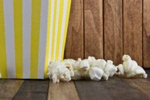 yellow and white striped bag with popcorn